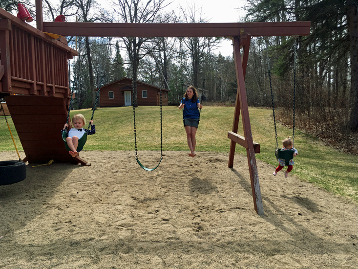 Liz, Mabel, and Mary Kate swinging at Half Moon Trail Resort