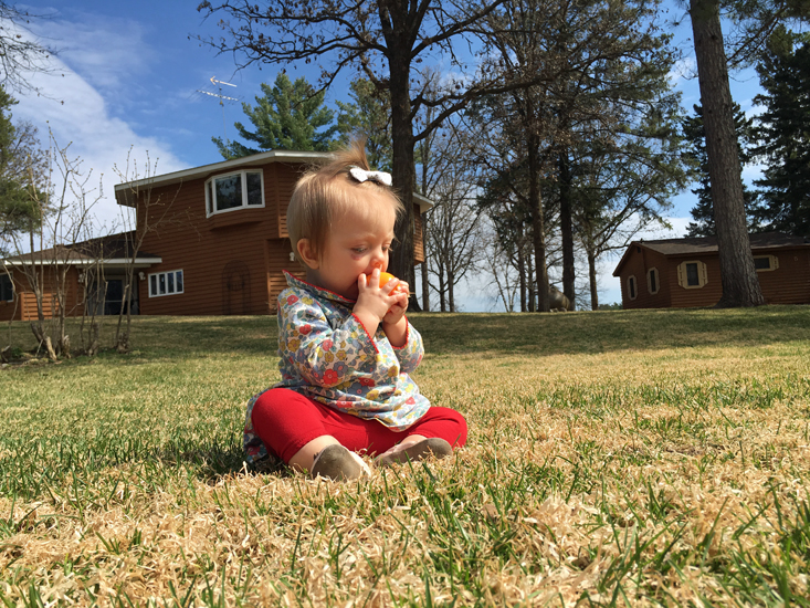 Mary Kate on the grass at Half Moon Trail Resort