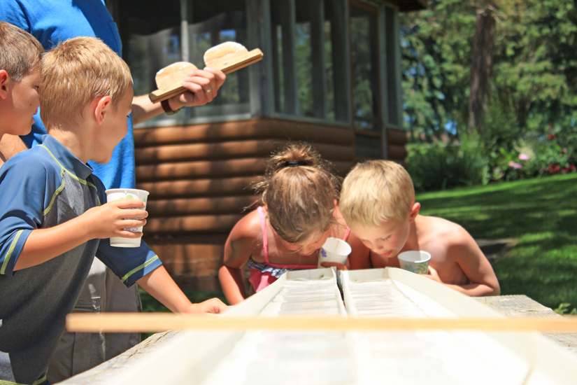 Two Kids at Half Moon Trail Resort in Park Rapids, MN participating in the Minnow Race Activity