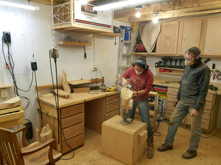 Michaela Ahrendt carving wood with Dave Ahrendt